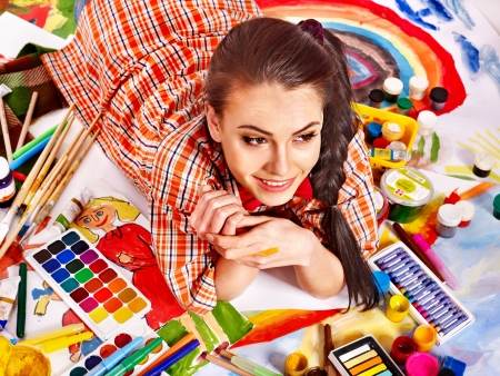 painter girl: Artist woman lying on paint palette. Stock Photo