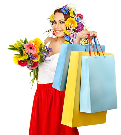 Woman with shopping bag holding flower. Isolated. Stock Photo - 18068778