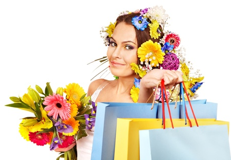 Woman with shopping bag holding flower. Isolated. Stock Photo - 18068797