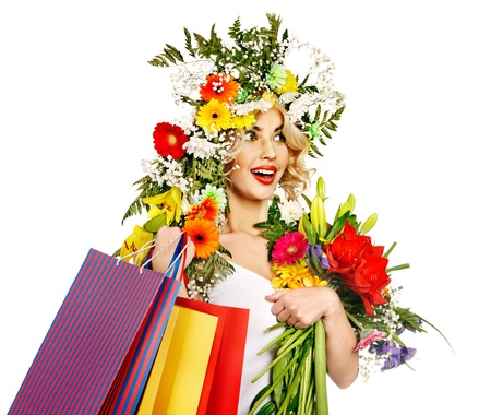 Woman with shopping bag holding flower. Isolated. Stock Photo - 18068795