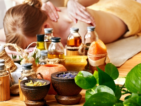 Woman getting massage in  spa. Still Life in the foreground. photo