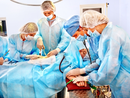 Team surgeon at work in operating room. At work.