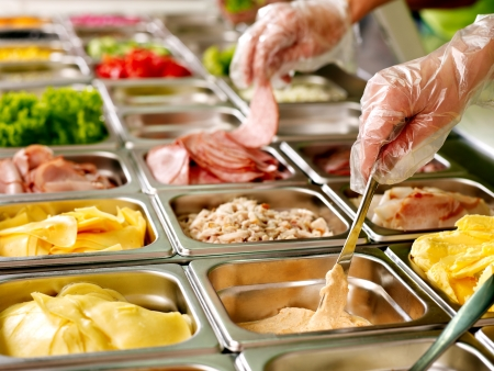 show case: Tray with cooked food on showcase at cafeteria. Stock Photo