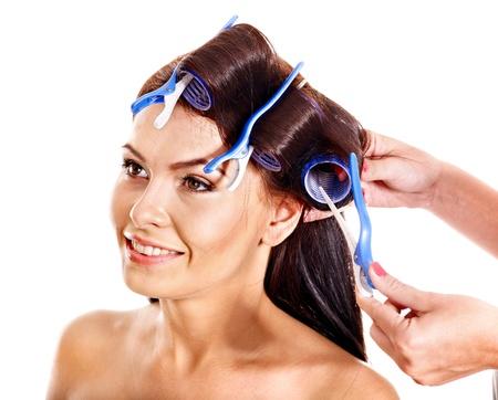 Happy beautiful woman wear hair curlers on head.
