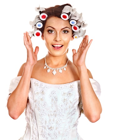 hair curlers: Woman with hair curlers on head wear in wedding dress . Stock Photo