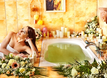 parlour: Woman relaxing at flower water spa. Stock Photo