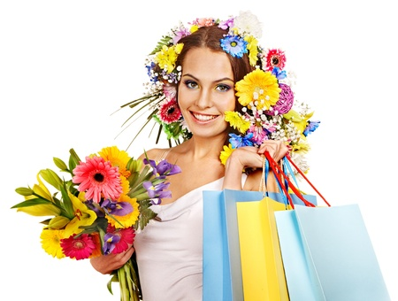 Woman with shopping bag holding flower. Isolated. Stock Photo - 18281637