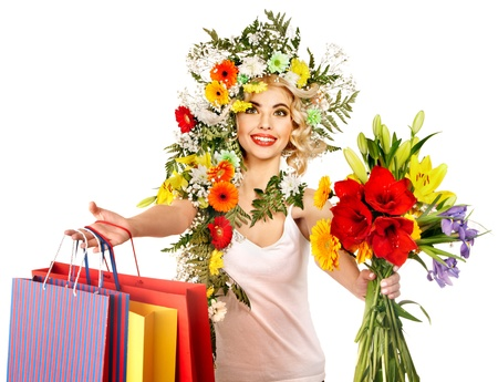 Woman with shopping bag holding flower. Isolated. Stock Photo - 18281740