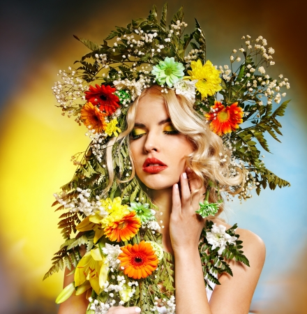 Portrait of woman with flower hairstyle.Art photo. photo