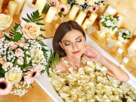 Woman applying moisturizer at bathroom. Stock Photo - 18282049
