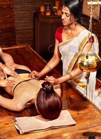 panchakarma: Young woman having Ayurveda spa treatment.