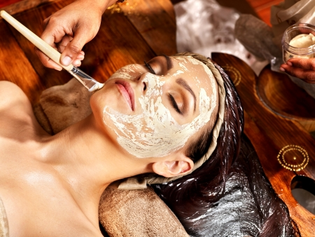 herbal remedy: Woman having facial mask at ayurveda spa. Stock Photo