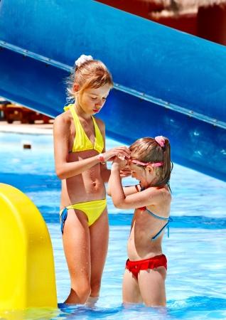 Children on water slide at aquapark. Summer holiday. Stock Photo - 18636116