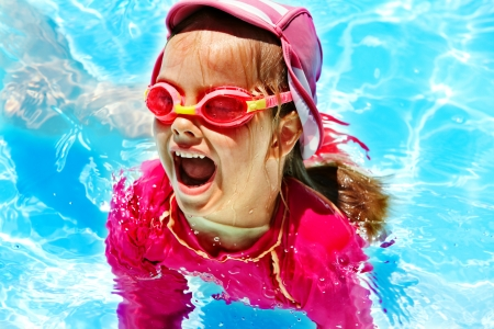 Child in swimming pool. Summer outdoor. photo