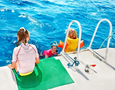 snorkling: Happy family with child on yacht. Snorkeling travel.