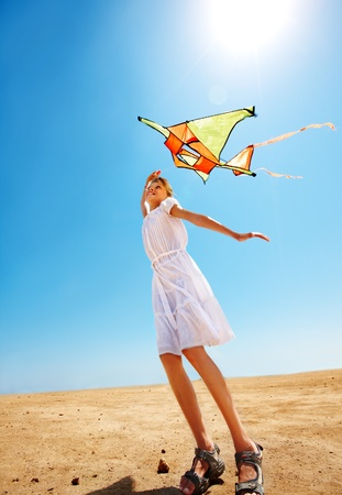 kite flying: Child flying kite beach outdoor. Stock Photo