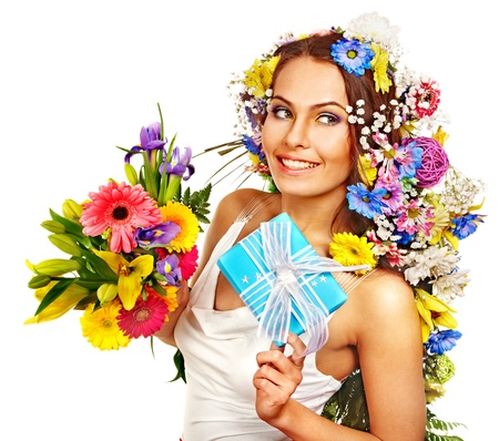 Woman with gift box and flower bouquet . Isolated. photo