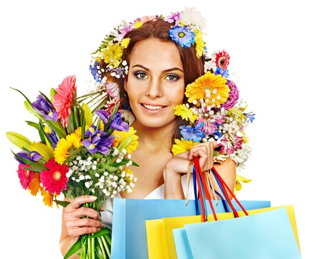 Woman with shopping bag holding flower. Isolated. Stock Photo - 18636153