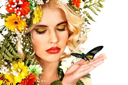 Face of woman with make up and butterfly. Isolated. Stock Photo - 18636234