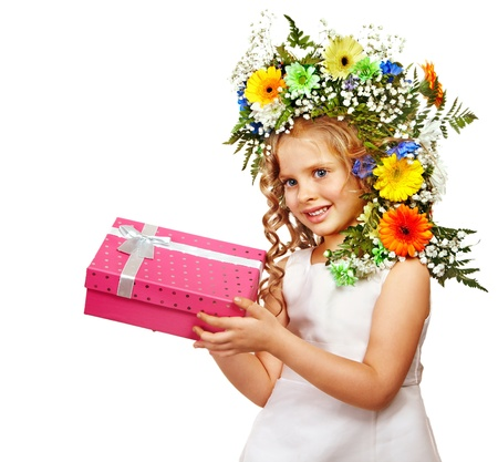 Little girl with gift box and flower. Isolated. photo