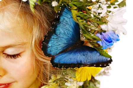 morpho menelaus: Face of child with flower and butterfly. Isolated.