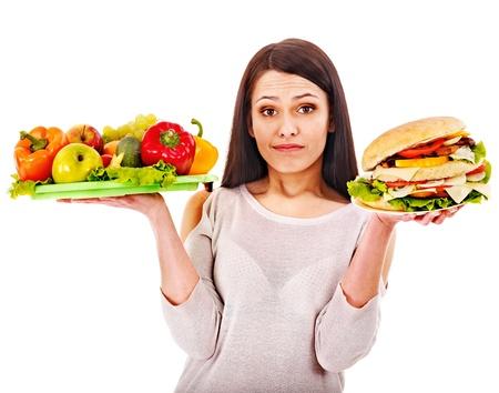 skinny girl: Woman choosing between healthy and unhealthy eating.
