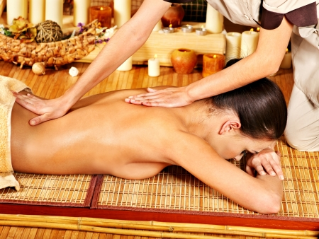 Woman getting  massage in spa. photo