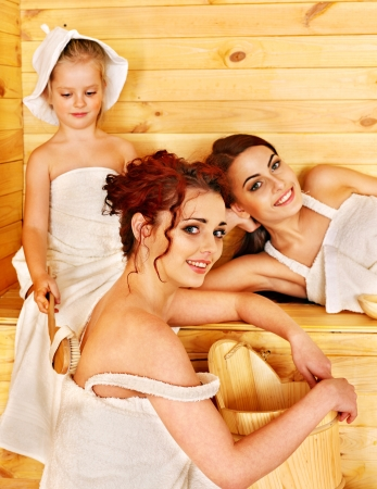Group people with child in sauna. Healthy lifestyle. photo