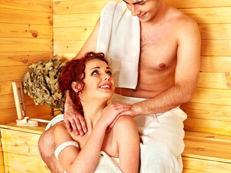 hot love: Group people in hat  relaxing at sauna.