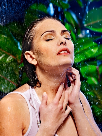 Wet woman with water drop. Nature. photo