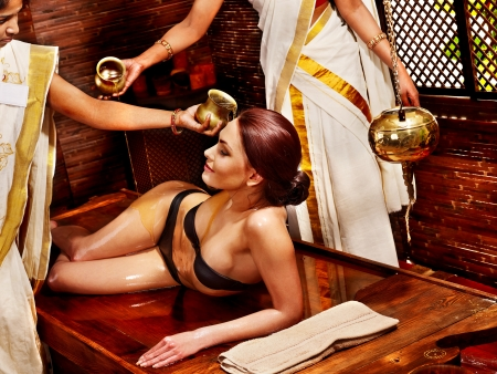 Young woman having oil Ayurveda spa treatment. Stock Photo - 18636250