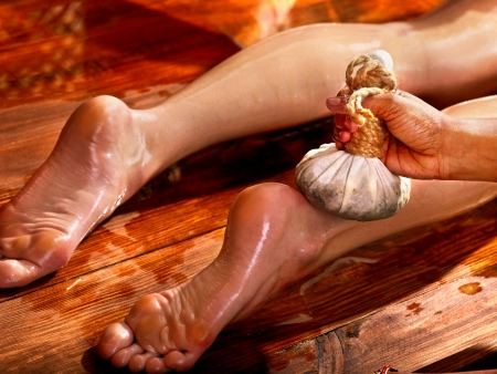 panchakarma: Young woman having feet Ayurveda spa massage.