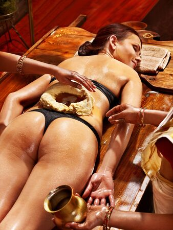 panchakarma: Woman having oil Ayurveda spa treatment of back pain. Stock Photo