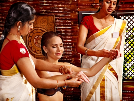 Young woman having ayurveda spa treatment. photo