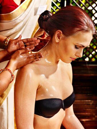 panchakarma: Young woman having neck Ayurveda spa treatment.