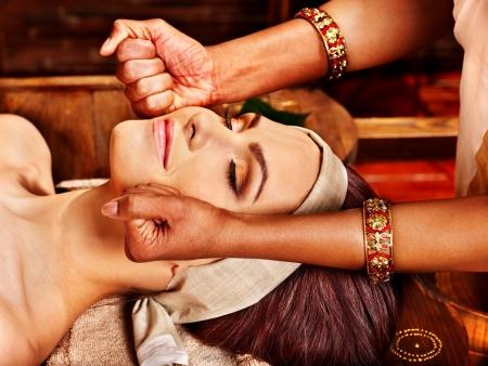 head massage: Woman having facial  ayurveda spa treatment.