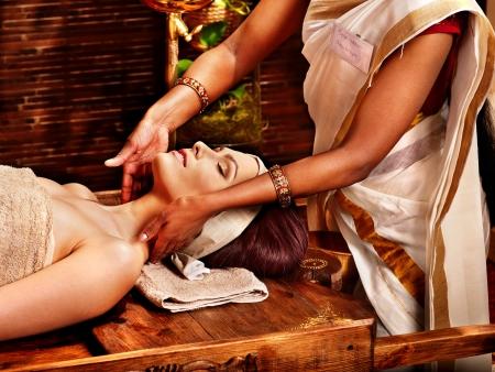 massage oil: Woman having facial  ayurveda spa treatment.