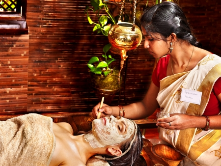 Woman having facial mask at ayurveda spa. Stock Photo - 18664807