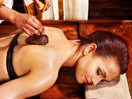 Young woman having body Ayurveda spa massage. photo