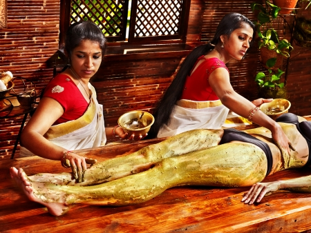 Young woman having feet Ayurveda spa massage. Stock Photo - 18664797