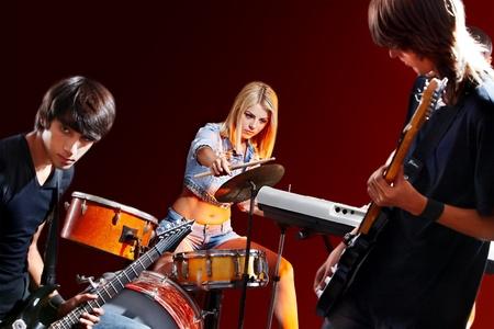 Group peole playing  guitar in night club. Stock Photo - 18810572