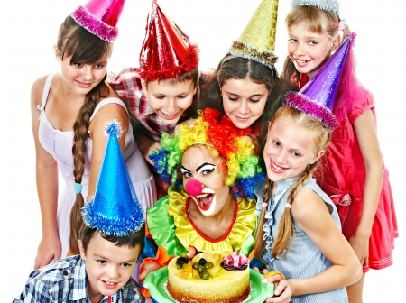 Birthday party of group teen with clown and cake. Isolated. Stock Photo - 18810685
