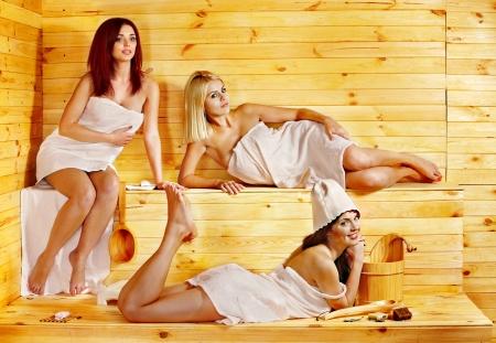 bathroom women: Group people relaxing in sauna.
