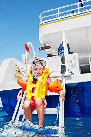 Happy  child on yacht. Snorkeling travel. photo