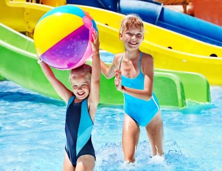 armbands: Child on water slide at aquapark. Summer holiday.