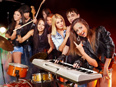live happy: Musical group male and female  performance in night club.