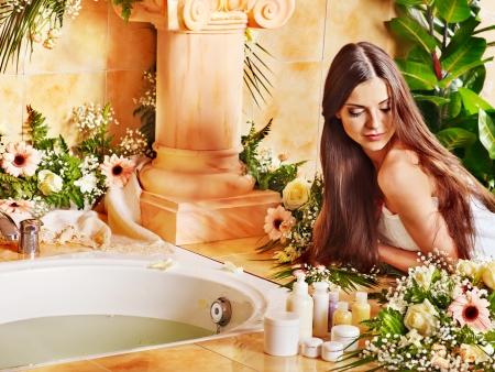 woman bath: Woman relaxing at water spa.