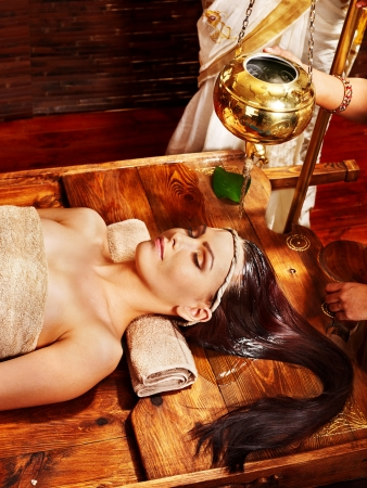 Young woman having oil Ayurveda spa treatment. Stock Photo - 18837869
