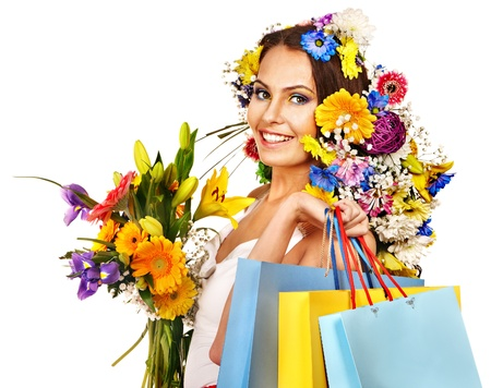 Woman with shopping bag holding flower. Isolated. Stock Photo - 18940350