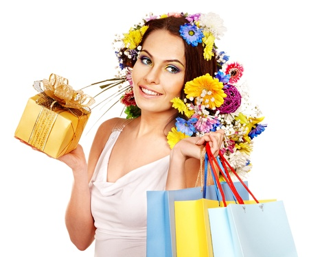 Woman with shopping bag holding flower. Isolated. Stock Photo - 18940327